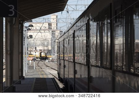 Convetional Train Parked At The Platform, Awaiting For Passengers