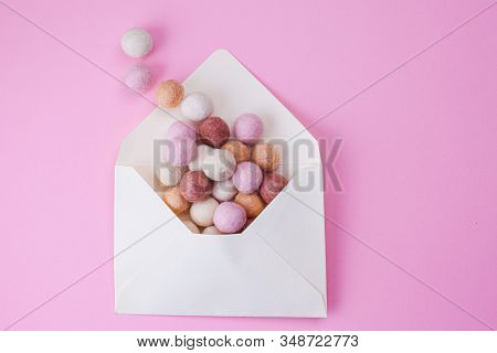 Colorful Handmade Felt Balls Fly Out Of Paper Envelope. Message, Mail And Letter Concept