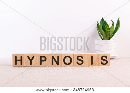 Hypnosis Word Made With Building Blocks On A Light Background