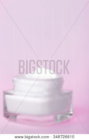 Face Cream Moisturizer Jar On Pink Background, Moisturizing Skin Care Lotion And Lifting Emulsion, A