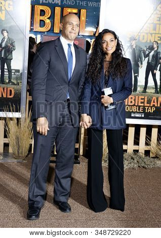 Rosario Dawson and Cory Booker at the Los Angeles premiere of 'Zombieland Double Tap' held at the Regency Village Theatre in Westwood, USA on October 10, 2019.