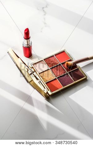 Cosmetics, Makeup Products Set On Marble Vanity Table, Lipstick, Eyeshadows And Make-up Brush For Lu