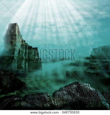 sunbeams shining underwater over rocks