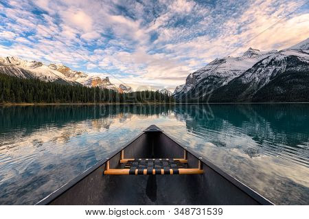 Canoeing On Maligne Lake With Canadian Rockies Reflection In Spirit Island At Jasper National Park,