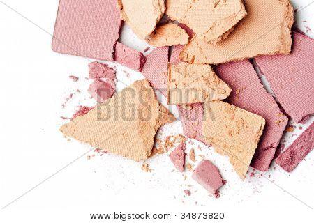 pink make up powder on white background