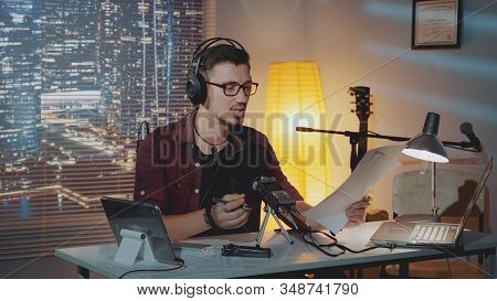 Home Recording Studio: The Speaker In Headphone Reads The Story Into The Microphone. There Is A Comp