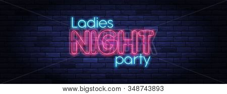 Ladies Night Party Neon Banner. Brightly Illuminated Neon Sign. Neon Lettering On Brick Wall Backgro
