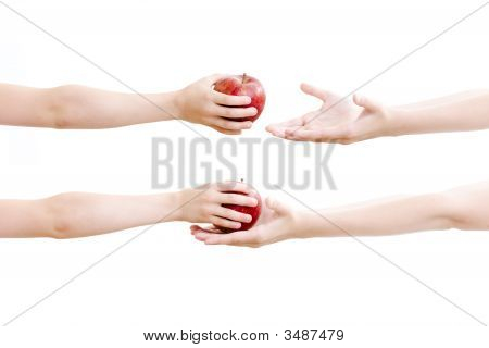 Girls passing red apple on each other (close up) poster