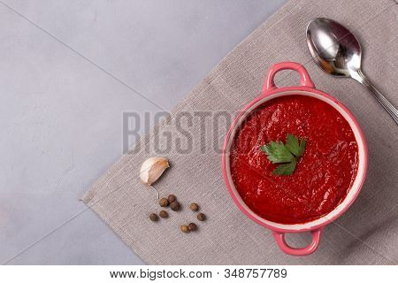 Tomato Soup With Parsley, Onion And Garlic On Gray Background. Comfortable Food. Rustic Style. Copy