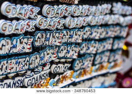 Rows Of Fridge Magnet Souvenirs From Gdansk Displayed On Stillage