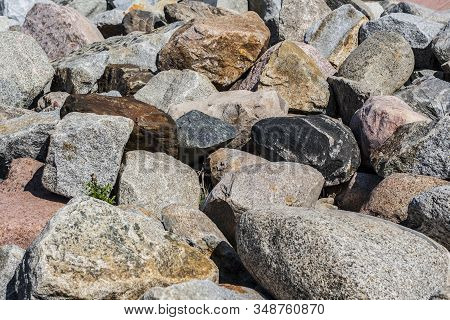 Blocks Of Different Kinds Of Stones Making Strengthening Of Sea Shore As Background