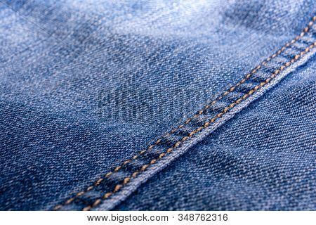 Jeans Texture. Denim. The Seam On The Fabric. Light Industry. Street Youth Fashion Style.