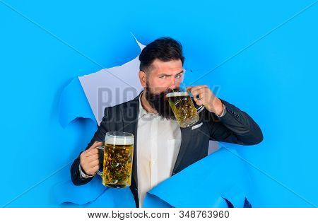 Drinks, Alcohol, Leisure, People Concept. Lager And Dark Beer. Bearded Man Holds Craft Beer Looking