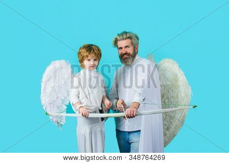 Father And Son Angels. Father's Day. Little Cupid Boy And Father With Bow And Arrow. Happy Father In