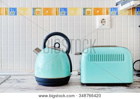 Close Up View On Work Top Two Objects Set, Toaster Electrical Device For Making Toast And Electric K