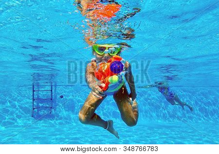 Funny 6 Or 7 Years Old Little Adorable Girl Having Fun Plunged Into Swimming Pool Aimed Water Gun At