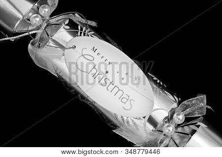 Silver Christmas cracker on black