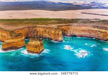 Australia, Port Campbell Park. The world-famous scenic spot on the ocean coast - The Twelve Apostles. Great Ocean Road. Helicopter flight. The concept of extreme, active and photo tourism