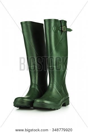 Green rubber boots on white