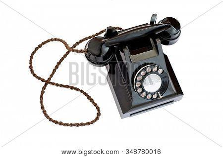 Vintage black telephone on white