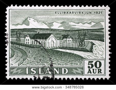 ZAGREB, CROATIA - JUNE 24, 2014: A stamp issued in Iceland shows Ellidaarvirkjun 1921, Waterfalls and Hydroelectric Power Plants series, circa 1956.