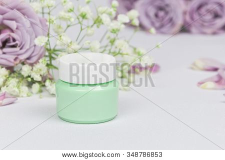 Green Cosmetic Jar With Cleansing Balm (oil) On A White Background With Flowers Roses And Petals, Mo