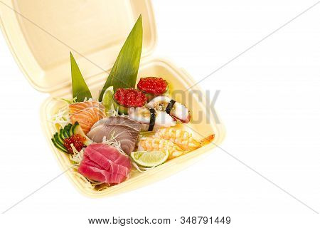 Traditional Japanese Food Sushi. Sushi Delivery In Thermo Box. Set Of Sushi, Nigiri And Maki. Delici