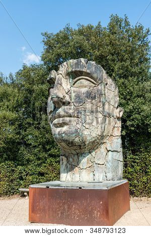 Florence, Italy - 26, March, 2016: Vertical Picture Of Human Face Sculpture Located In The Boboli Ga