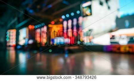 Blurred Background Of An Esports Event - Big Illuminated Main Stage Of A Computer Games Tournament L