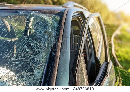 Broken Windshield In A Car After A Crash, And Driving While Alcohol Intoxicated.