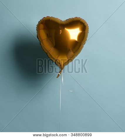 Metallic Foil Single Gold Heart Balloon Object For Birthday Party Or Valentines Day On Pastel Color