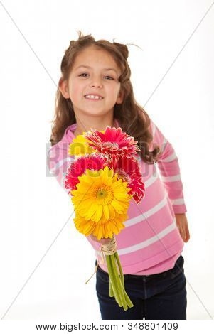Smiling girl with a present of flowers for mothers day