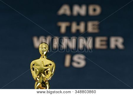 Xalapa, Veracruz, Mexico- January 31, 2020: Plastic Oscar Award And Blurred Wooden Letters With The