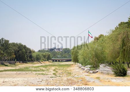 Flag Of The Islamic Republic Of Iran Waiving In Front Of The Zayandeh River, Dried Due To The Especi