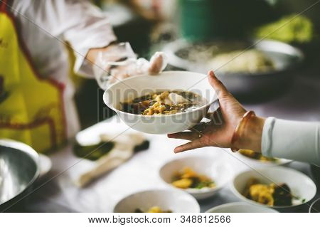 The Hand Of The Poor Receives Food From The Hand Of The Giver : Concept Of Helping With Feeding
