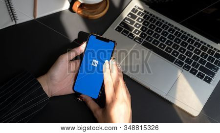 Chiang Mai, Thailand - February 1, 2020 : Female Using Iphone With Linkedin Screen. Linkedin Helps B