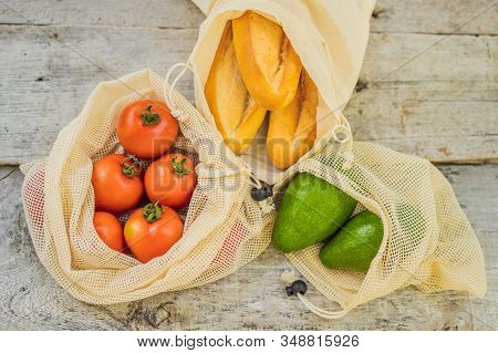 Fresh Bread, Avocado And Tomatoes In A Reusable Bag On A Stylish Wooden Kitchen Surface. Zero Waste