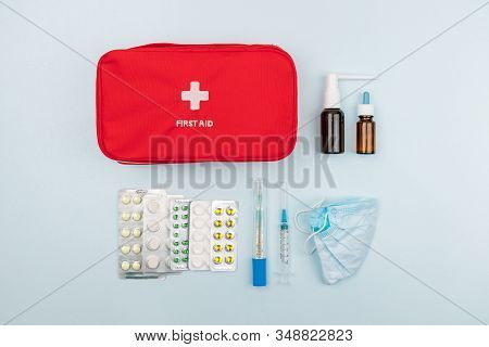 Red Home First Aid Kit. Box For Medicines, Antibiotics And Medicaments. Near Pills In A Blister Pack