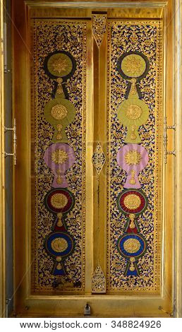 Bangkok, Thailand -january 30, 2020 : The Wood Carving Door Panels With Painted Royal Insignias On A