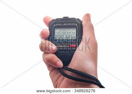 Hand Holding A Stopwatch Isolated On White Background With Clipping Path, Electronic Sport Timer In