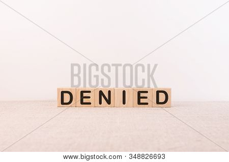 Denied Word Concept On Cubes And Light Background