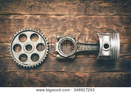 Old Car Spare Parts On Wooden Workbench Background. Machinery Abstract Background.