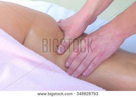 Man Doctor Making Sculptural Body Lift Anti-cellulite Massage On Womans Body In Clinic, Leg Closeup.