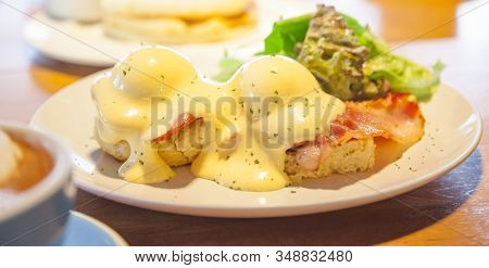 Selective Focused Eggs Benedict, A Sandwich Consists Of 2 Halves Of English Muffin Topped With Poach