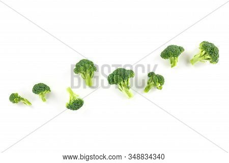 Broccoli Florets, Overhead Shot On A White Background With Copy Space