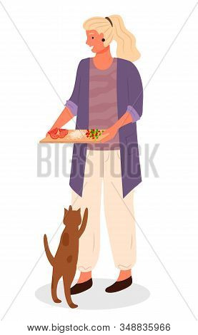 Woman Hold Cutting Board With Sliced Vegetables For Cooking Food. Cat Jumping And Begging Food From