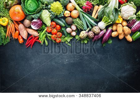Panoramic colorful food background with assortment of fresh organic vegetables with copy space