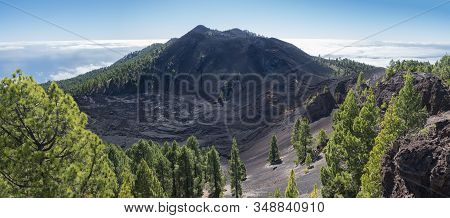 Panoramic Landscape With Lush Green Pine Trees, Colorful Volcanoes And Lava Crater Deseada Along Pat