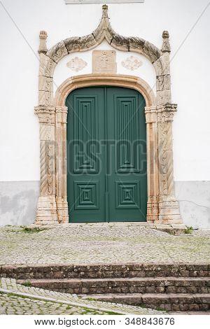 Green Doorway Of The Ancient Igreja Matriz De Alte Church In The Small Town Of Alte, Portugal
