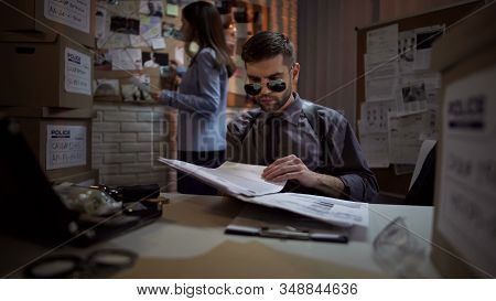 Private Detective Reading Papers Of Criminal Case, Systematizing Information